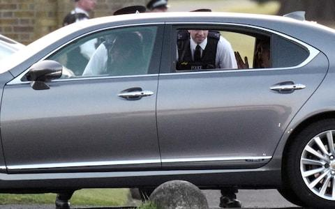 George and Amal Clooney had a 10 minute wait to get into the grounds of Frogmore House - Credit: w8media