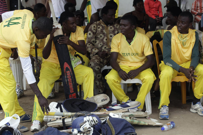 In this photo taken Friday, Nov. 30, 2012, Ogun state cricket team take a break at halftime while playing Lagos state during the 18th National sports festival in Lagos, Nigeria. Near the parade ground that Queen Elizabeth II once toured when this nation still was under British rule, the sharp crack of a ball against a bat marks the rebirth of a colonial sport now finding a second life. Cricket, once the preserve of Nigeria's educated elite, is finding favor in schools for poor children and in the streets of some of the nation's most violence-torn cities. Yet cricket has a long history in the country. British colonialists introduced the game to boarders in Nigeria's top secondary schools in the 19th century. Nigeria played its first recorded international game in 1904 against present-day Ghana, local cricket officials say. (AP Photo/Sunday Alamba)