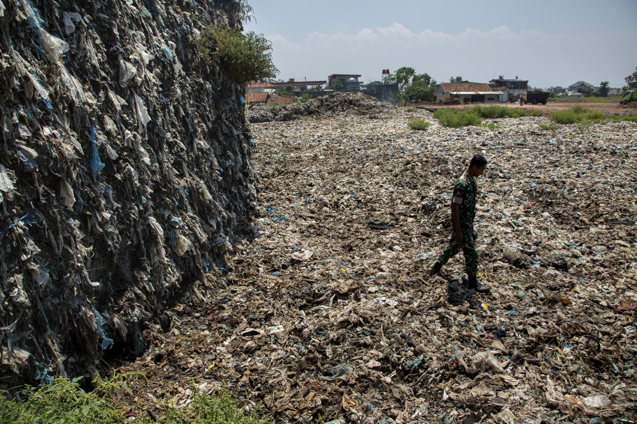 <p>A 20-year accumulation of plastic trash fished out of the Citarum River sits at a dump site being monitored by the Indonesian army on Aug. 28, 2018, outside Bandung, Java, Indonesia. (Photo: Ed Wray/Getty Images) </p>