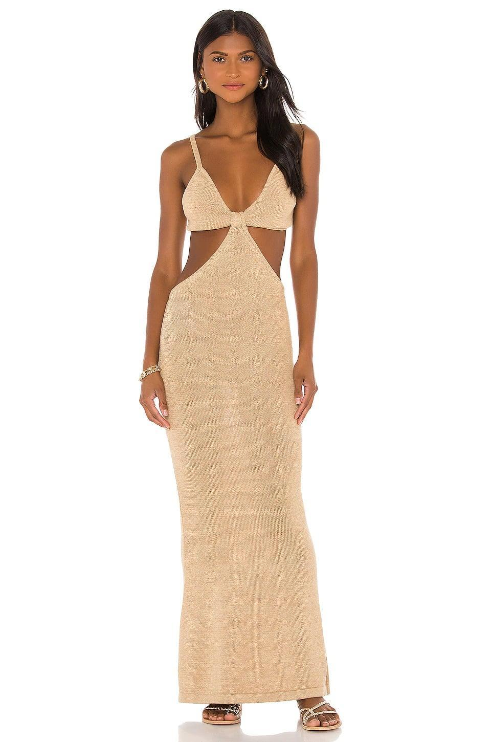 <p>If you've been online in the last two years, you've seen this cult classic <span>Cult Gaia Serita Knit Dress</span> ($458). It comes in a bunch of different colors, but we love the beachy vibe of this neutral style.</p>