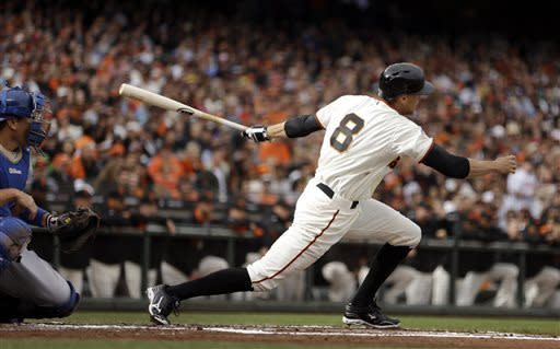 San Francisco Giants' Hunter Pence swings for a ground out which led to a run scored on a fielders choice in the first inning of a baseball game against the Los Angeles Dodgers Sunday, May 5, 2013, in San Francisco. (AP Photo/Ben Margot)
