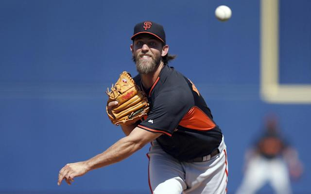 San Francisco Giants' Madison Bumgarner throws a pitch against the Milwaukee Brewers during the fifth inning of a spring training baseball game, Tuesday, March 25, 2014, in Phoenix. (AP Photo/Ross D. Franklin)