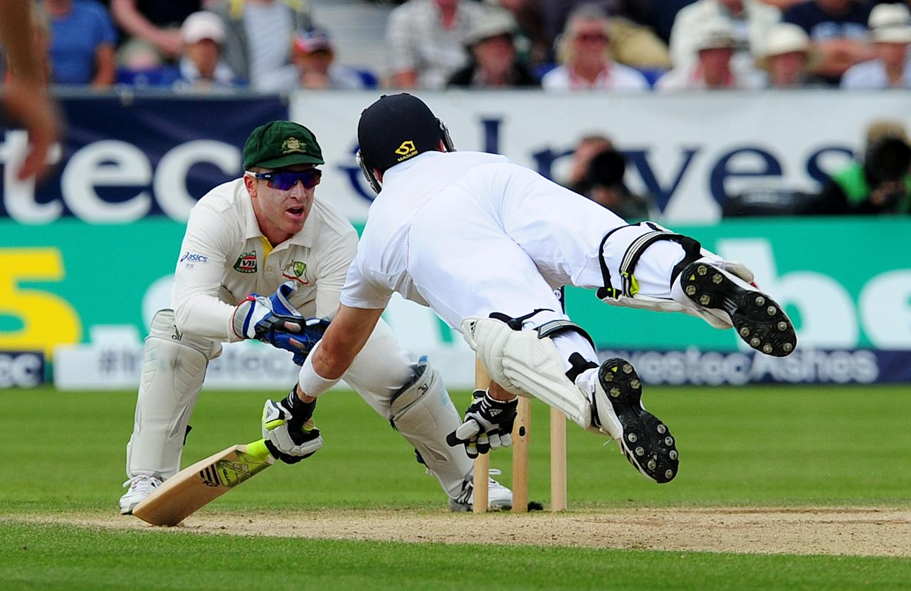 England's Kevin Pietersen dives back into his crease and avoids being stumped by Australia's Brad Haddin during day three of the Fourth Investec Ashes test match at the Emirates Durham ICG, Durham.