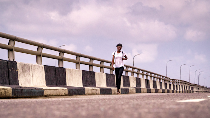 A woman walking on the Third Mainland Bridge in Lagos, Nigeria