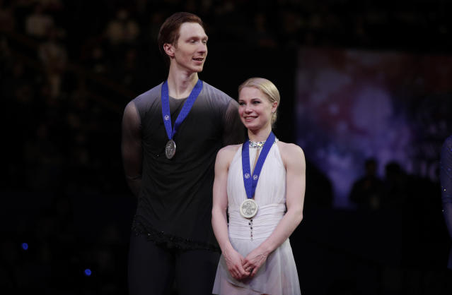 Russia's Evgenia Tarasova and Vladimir Morozov stand with their silver medals for the pairs free skate during the ISU World Figure Skating Championships at Saitama Super Arena in Saitama, north of Tokyo, Thursday, March 21, 2019. (AP Photo/Andy Wong)