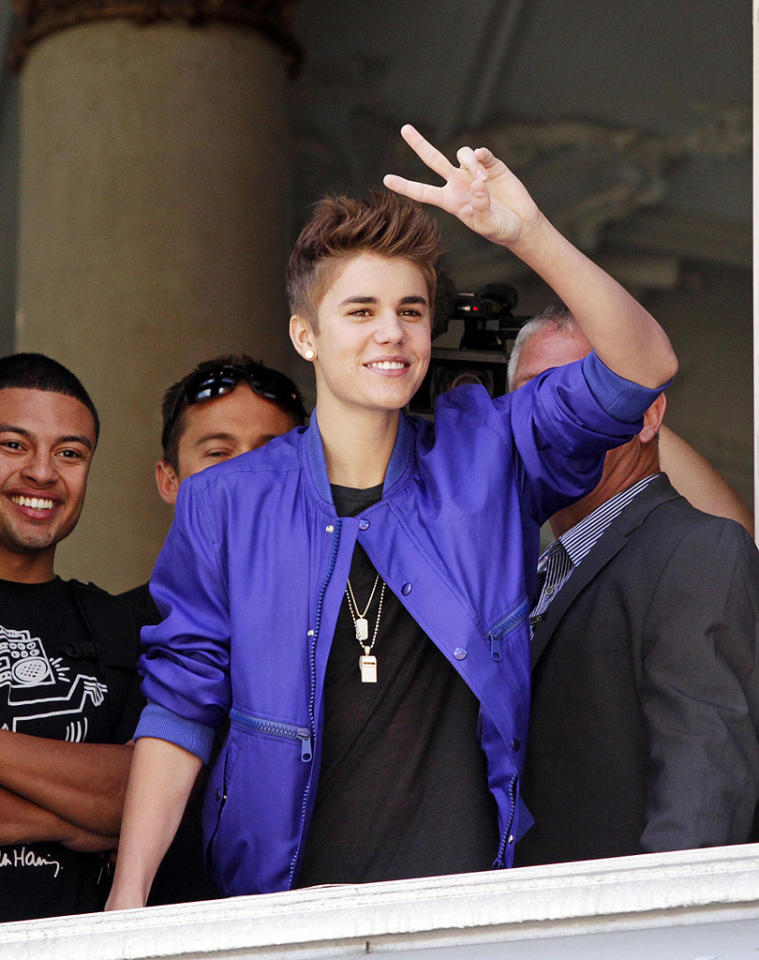 "<p class=""MsoNormal""><span style="""">Let's keep it peaceful, girls! Justin Bieber flashed a peace sign in Oslo, Norway, on Wednesday, the same place where a chaotic scene took place earlier in the week as thousands of fans swarmed the city's Opera House, hoping to get into Bieber's upcoming free concert, prompting 15 girls to pass out. ""NORWAY - please listen to the police. I dont want anyone getting hurt. I want everything to go to plan but your safety must come first..."" the teen idol tweeted on Thursday. (5/30/2012)</span></p>"