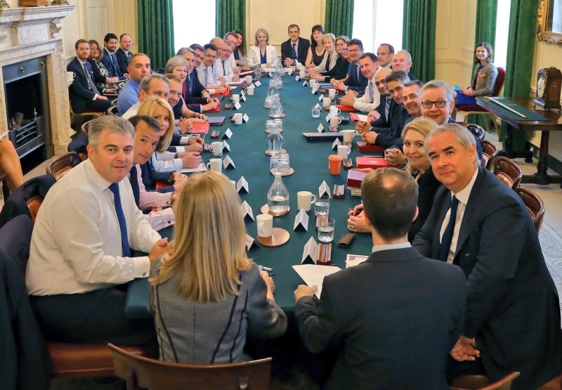 This is a handout photo provided by Downing Street showing a Cabinet meeting, in London, Tuesday, July 10, 2018. British Prime Minister Theresa May has met with her Cabinet as she tries to restore government unity after the resignations of two top ministers over Brexit. Tuesday's meeting comes after Foreign Secretary Boris Johnson and Brexit Secretary David Davis quit, saying May's plans for future relations with the European Union don't live up to their idea of Brexit. (Downing Street via AP)