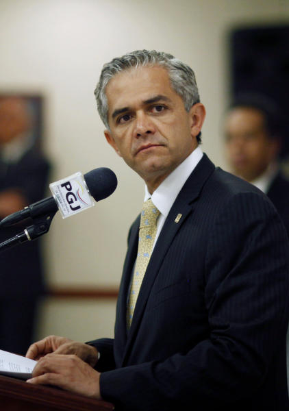 FILE - In this Oct. 27, 2010 file photo, Mexico City's Attorney General Miguel Angel Mancera listens to journalists during a press conference in Mexico City. Mancera, who is running for mayor of Mexico City, holds an astonishing lead of about 50 points in polls going into the July 1 vote, which coincides with the 2012 presidential election. Mancera is campaigning on his reputation as the city's attorney general and a 12 percent drop in crime from 2010 to 2011. (AP Photo/Alexandre Meneghini, File)