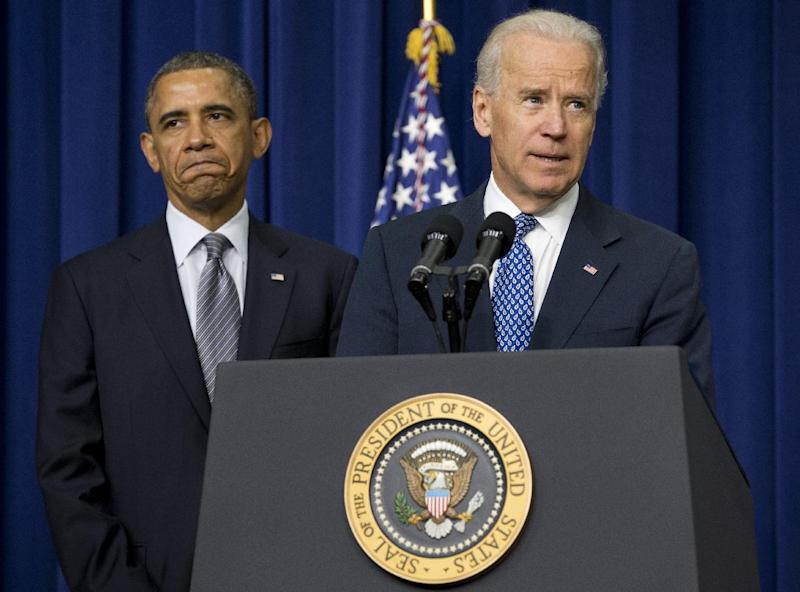FILE - In this Jan. 16, 2013, file photo, President Barack Obama listens at left as Vice President Joe Biden speaks about proposals to reduce gun violence in the South Court Auditorium at the White House in Washington. There is a legal avenue to get any gun you want somewhere in the U.S., thanks to the maze of gun statutes across the country and the lack of federal laws. An Associated Press analysis finds that there are thousands of laws, rules and regulations at the local, county, state and federal levels. (AP Photo/Carolyn Kaster, File)