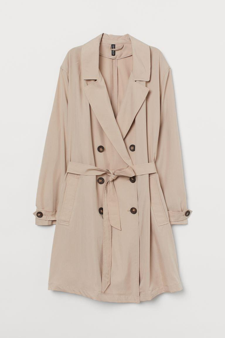 """<br><br><strong>H&M Plus</strong> Lightweight Trenchcoat, $, available at <a href=""""https://www2.hm.com/en_gb/productpage.0853554002.html"""" rel=""""nofollow noopener"""" target=""""_blank"""" data-ylk=""""slk:H&M"""" class=""""link rapid-noclick-resp"""">H&M</a>"""
