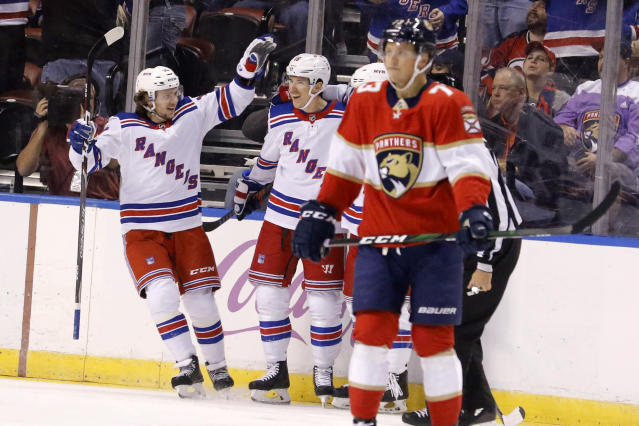 New York Rangers center Ryan Strome (16) is congratulated by center Artemi Panarin, left, after his first-period goal as Florida Panthers left wing Dryden Hunt (73) reacts during an NHL hockey game, Saturday, Nov. 16, 2019, in Sunrise, Fla. (AP Photo/Joe Skipper)