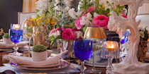 """<p>Looking for a fresh take on an autumn table set-up? Go for a chic maximalist look with an abundance of vibrant flowers, succulents, and crystal candle holders. Design by <a href=""""http://lizcaan.com/"""" rel=""""nofollow noopener"""" target=""""_blank"""" data-ylk=""""slk:Liz Caan"""" class=""""link rapid-noclick-resp"""">Liz Caan</a>. </p>"""
