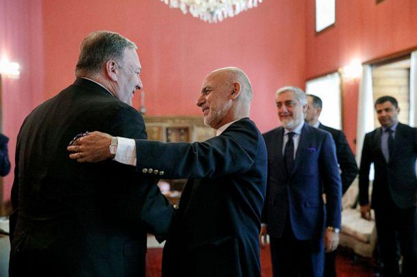 PHOTO: Secretary of State Mike Pompeo, left, is greeted by Afghan President Ashraf Ghani, at the Presidential Palace in Kabul, Afghanistan, June 25, 2019, during an unannounced visit. At right is Afghan Chief Executive Officer Abdullah Abdullah. (Jacquelyn Martin/Pool via AP)
