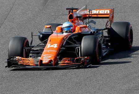 FILE PHOTO: Formula One F1 - Japanese Grand Prix 2017 - Suzuka Circuit, Japan - October 8, 2017. McLaren's Fernando Alonso of Spain in action. REUTERS/Toru Hanai/File Photo