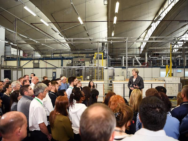 Britain's Prime Minister, Theresa May, addresses staff at GlaxoSmithKline toothpaste factory in Maidenhead, April 21, 2017. REUTERS/Leon Neal/Pool