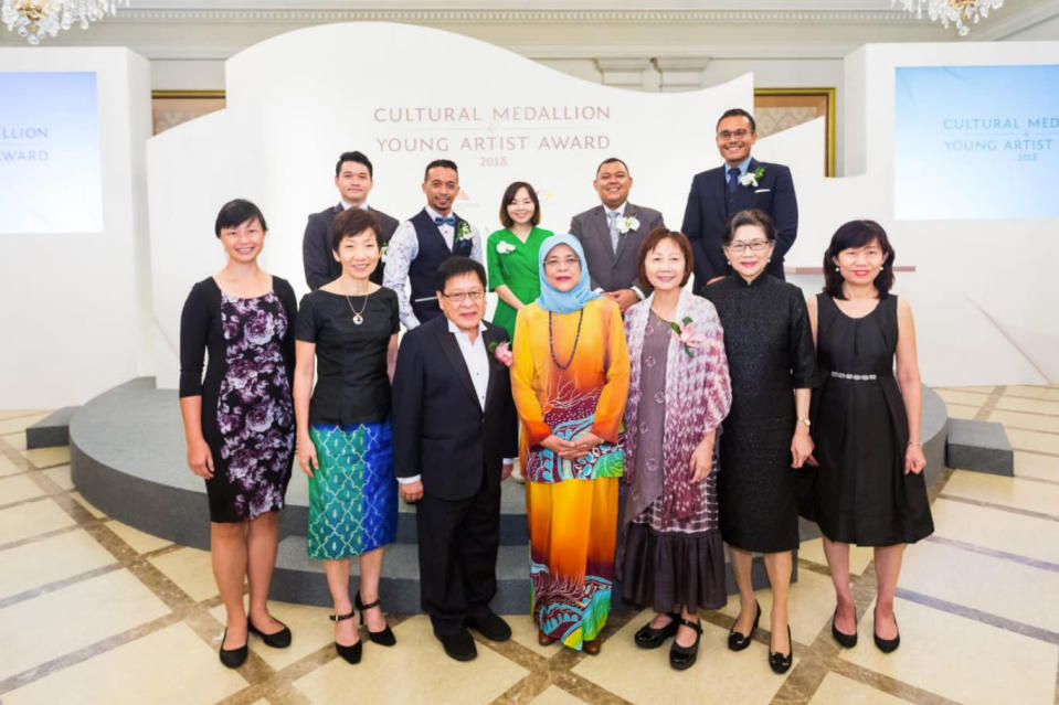 President Halimah Yacob (first row, centre) with Cultural Medallion recipients and Young Artist Award recipients. (PHOTO: National Arts Council)