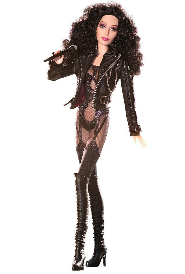 "<div class=""caption-credit""> Photo by: barbiecollector.com</div><b>'80s Cher Bob Mackie doll, released in 2007 for $34.95</b> <br> Dressed in a studded faux leather jacket, skimpy bodysuit, and over-the-knee boots, this doll's item description says ""not for use with other Barbie dolls"" and we understand why. She'd kick that blond prude's little butt."