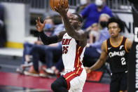 Miami Heat's Kendrick Nunn (25) scores past Cleveland Cavaliers' Collin Sexton (2) during the second half of an NBA basketball game, Saturday, May 1, 2021, in Cleveland. (AP Photo/Ron Schwane)