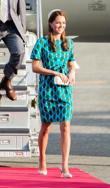 Even when she is disembarking from a plane, Kate still manages to look perfect and polished. Here she is getting off the plane in Honiara, decked out in an aqua geometric print dress by Jonathan Saunders. The printed dress retails for $1,490 on Net-a-Porter. She accessorizes with a clutch bag and her favourite L.K. Bennett pumps. (Photo by Samir Hussein/WireImage)