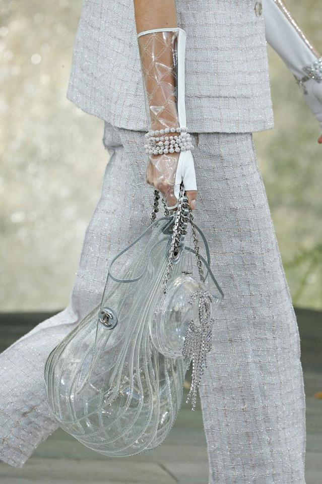 <p>A runway model carries a transparent bucket bag and round chain bag during the Chanel pring/Summer 2018 show in Paris. (Photo: Getty Images) </p>