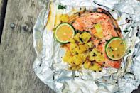 """<p>This salmon gets a sweet kick from pineapple salsa.</p><p>Get the recipe from <a href=""""https://www.delish.com/cooking/recipe-ideas/recipes/a43206/foil-pack-salmon-pineapple-salsa-recipe/"""" rel=""""nofollow noopener"""" target=""""_blank"""" data-ylk=""""slk:Delish"""" class=""""link rapid-noclick-resp"""">Delish</a>.</p>"""