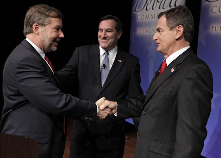 Candidates for Indiana's U.S. Senate seat Libertarian Andrew Horning, left, Democrat Joe Donnelly, center, and Republican Richard Mourdock greet one and other following a debate in New Albany, Ind., Tuesday, Oct. 23, 2012. (AP Photo/Michael Conroy)