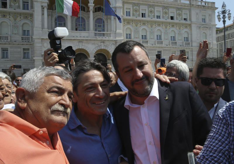 "Italy's deputy prime minister Matteo Salvini, right, is greeted by supporters in Trieste, Italy, Friday, July 5, 2019. Salvini said Friday that Italy is ready to use more resources to ""seal the border with Slovenia and definitively stop the entrance of illegal migrants."" But he stopped short of mentioning a plan to build an anti-migrant wall along the Slovenian border, previously mentioned by the League's regional governor. (AP Photo)"