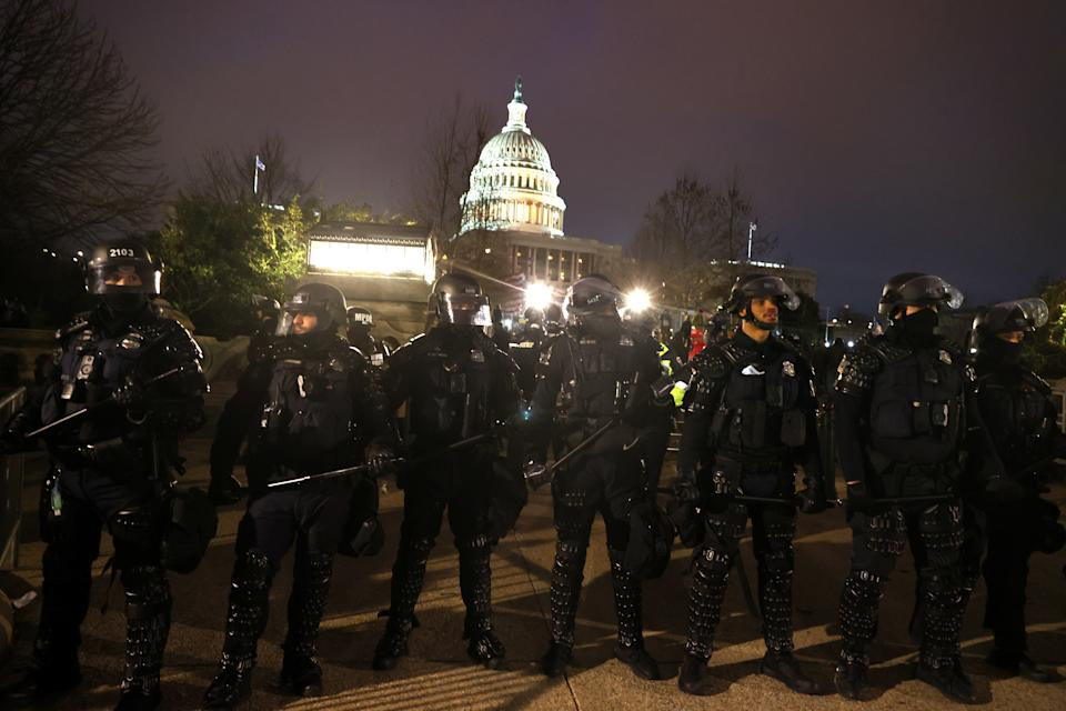 WASHINGTON, DC - JANUARY 06: Police officers in riot gear line up as protesters gather on the U.S. Capitol Building on January 06, 2021 in Washington, DC. Pro-Trump protesters entered the U.S. Capitol building after mass demonstrations in the nation's capital during a joint session Congress to ratify President-elect Joe Biden's 306-232 Electoral College win over President Donald Trump. (Photo by Tasos Katopodis/Getty Images)