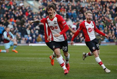 Soccer Football - Premier League - Burnley vs Southampton - Turf Moor, Burnley, Britain - February 24, 2018 Southampton's Manolo Gabbiadini celebrates scoring their first goal with Josh Sims REUTERS/Andrew Yates