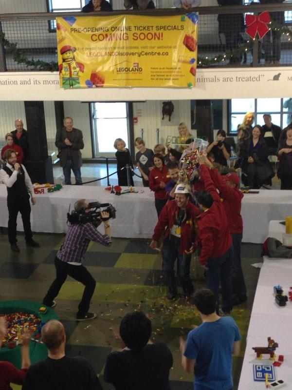 People pour bricks over winner Graeme Dymond at the end of Sunday's competition. Dymond will become the new master model builder at LEGOLAND Toronto.