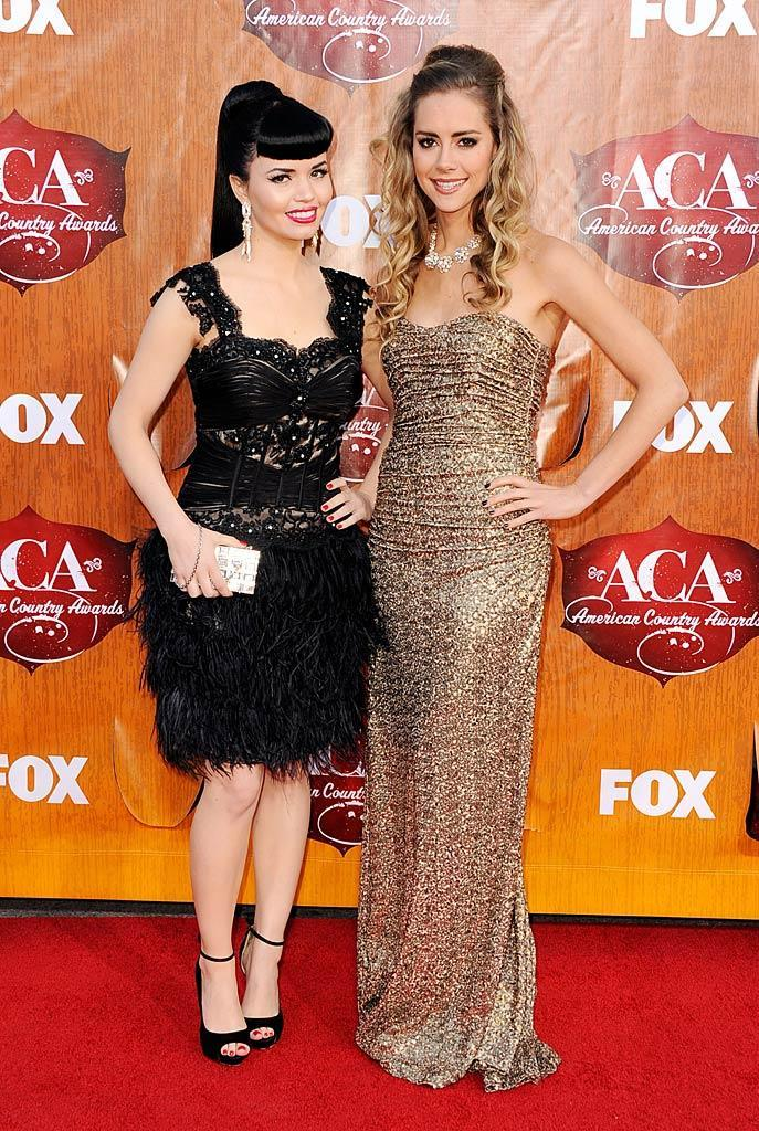 Susie Brown (left) and Danelle Leverett of The JaneDear Girls arrive at the American Country Awards held at the MGM Grand Garden Arena in Las Vegas. (12/05/2011)