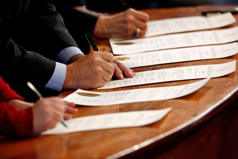 FILE PHOTO: North Carolina Electoral College representatives sign the Certificates of Vote in the State Capitol building in Raleigh, North Carolina