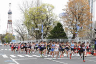 Runners start at the Sapporo challenge half-marathon held as a Tokyo 2020 Olympics test event in Sapporo, northern Japan, Wednesday, May 5, 2021. Sapporo TV Tower is seen at left in the background. (Kyodo News via AP)