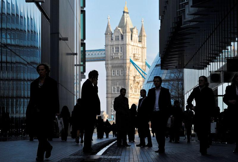 FILE PHOTO - Office workers are seen in the London Place business district near Tower Bridge in central London
