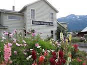 """<p>Olivia's Alaskan Bistro is a storied spot to dine at <a href=""""https://www.tripadvisor.com/Hotel_Review-g60877-d72447-Reviews-Historic_Skagway_Inn-Skagway_Alaska.html"""" rel=""""nofollow noopener"""" target=""""_blank"""" data-ylk=""""slk:this inn"""" class=""""link rapid-noclick-resp"""">this inn</a> in Skagway, AK. The original location opened in 1897 as a bed and breakfast and restaurant for those drawn to the Klondike Gold Rush, and you can still enjoy fresh seafood and ingredients from the onsite garden.</p>"""