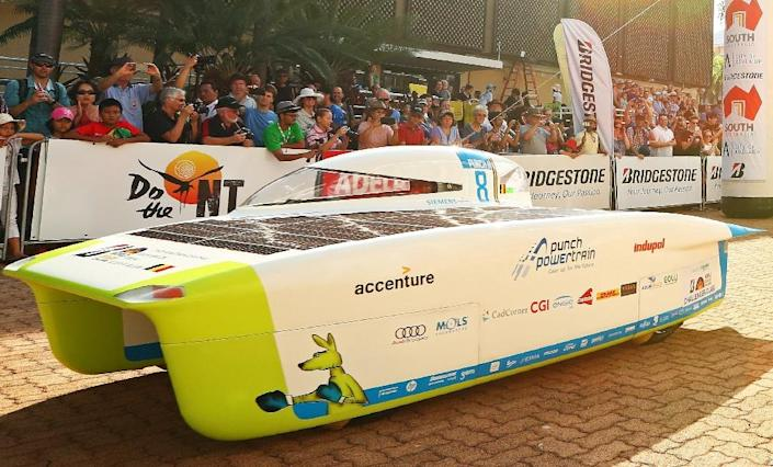 The event has become one of the world's foremost innovation challenges with teams looking to demonstrate designs that could one day lead to commercially available solar-powered vehicles for to carry freight or passengers. (AFP Photo/Scott Barbour)