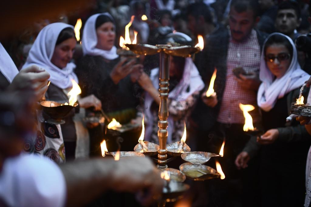 Of the world's 1.5 million Yazidis, the largest community was in Iraq where it comprised some 550,000 people before being scattered by the IS offensive (AFP Photo/CHRISTOPHE SIMON)