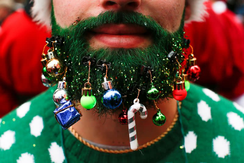 FILE PHOTO: A reveler takes part in the event called SantaCon at Times Square in New York