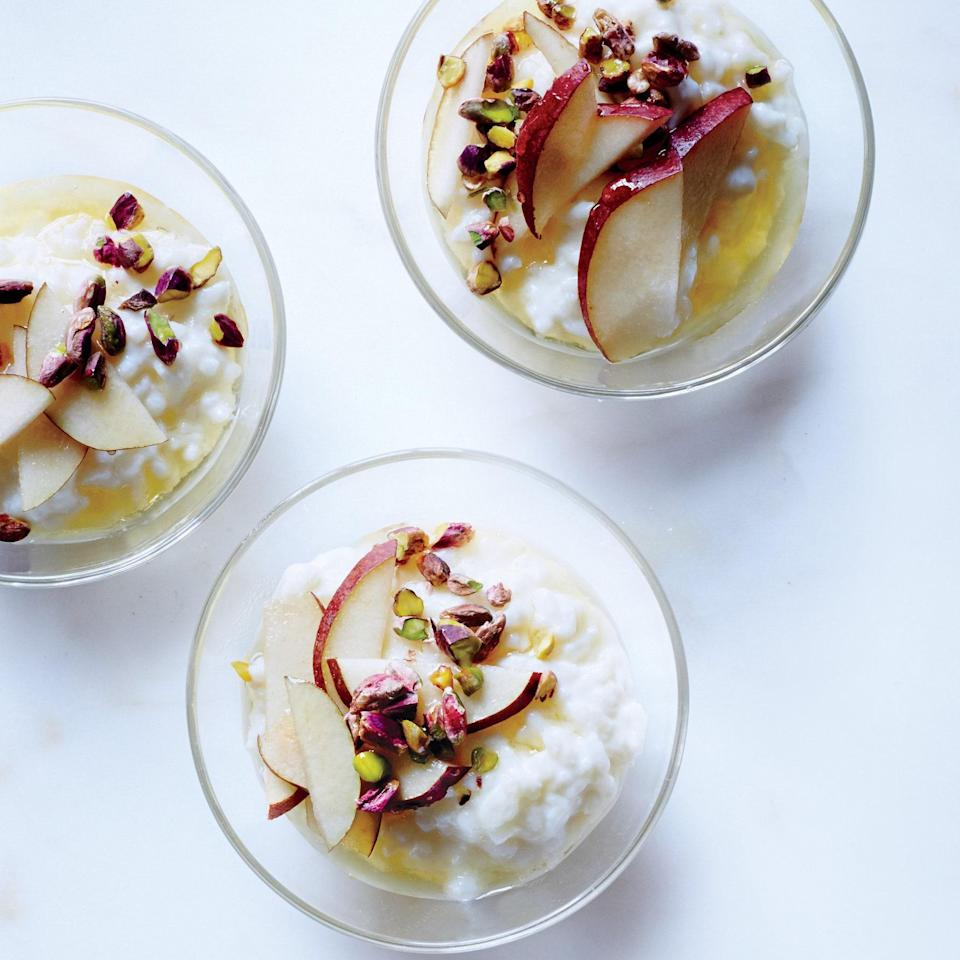 """We love that pear recipes can delight at every meal. This comforting rice pudding starts with bomba or arborio rice, simmered in whole milk until creamy and tender. Sure, it could be dessert, but it's excellent for breakfast, topped with pear slices, chopped pistachios, and a drizzle of honey. <a href=""""https://www.epicurious.com/recipes/food/views/rice-pudding-with-fresh-pears-and-honey-51246410?mbid=synd_yahoo_rss"""" rel=""""nofollow noopener"""" target=""""_blank"""" data-ylk=""""slk:See recipe."""" class=""""link rapid-noclick-resp"""">See recipe.</a>"""