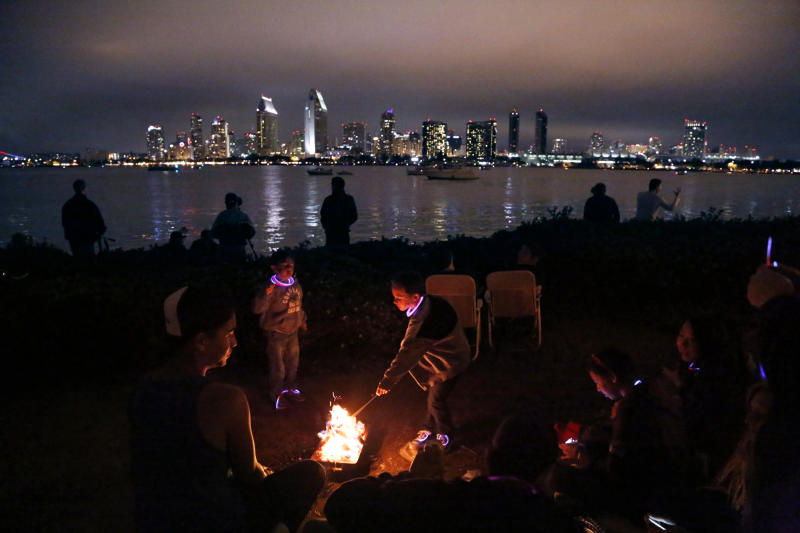 Tyler Christensen, 7, and brother Logan, 5, roast marshmallows on Coronado Island in San Diego while waiting for the Fourth of July fireworks display Wednesday, July 4, 2012. A malfunction caused all of the fireworks to go off at once, disappointing many spectators who expected to see a 15-minute performance over San Diego Bay. The Coast Guard says the mishap occurred minutes before the scheduled opening of the Big Bay Boom show. More than 500,000 people witnessed the short-lived spectacle. No injuries were reported. (AP Photo/The U-T San Diego, James Gregg) MANDATORY CREDIT: Photo by James Gregg U-T San Diego; NO SALES, NO ARCHIVING, SAN DIEGO COUNTY OUT, TV OUT, MAGS OUT, FOREIGN OUT, TABLOIDS OUT, AP IMAGES OUT, COMMERCIAL INTERNET USE OUT.