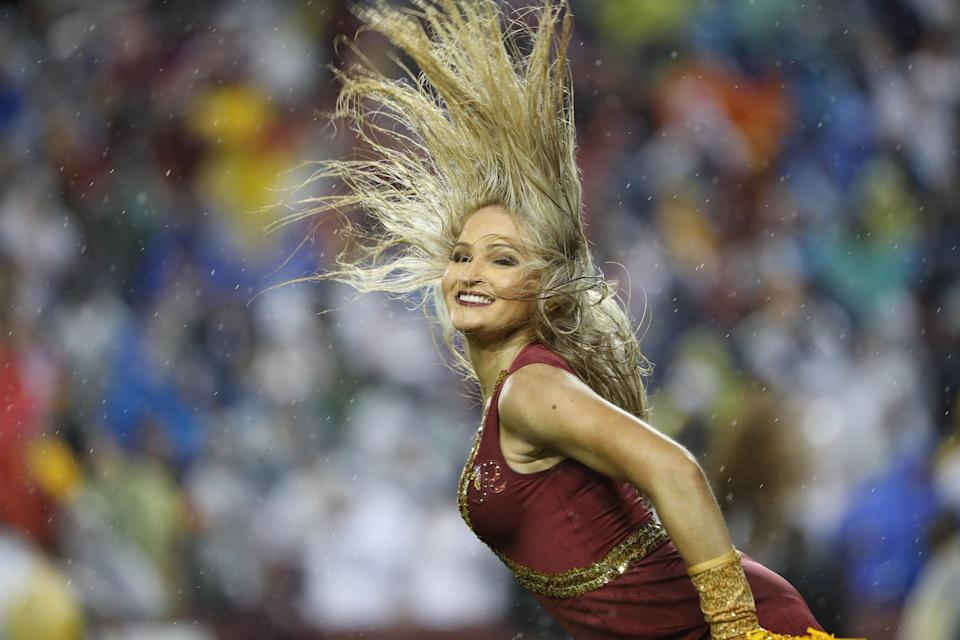 <p>A Washington Redskins cheerleader dances during a timeout during the fourth quarter at FedEx Field on October 29, 2017 in Landover, Maryland. (Photo by Patrick Smith/Getty Images) </p>