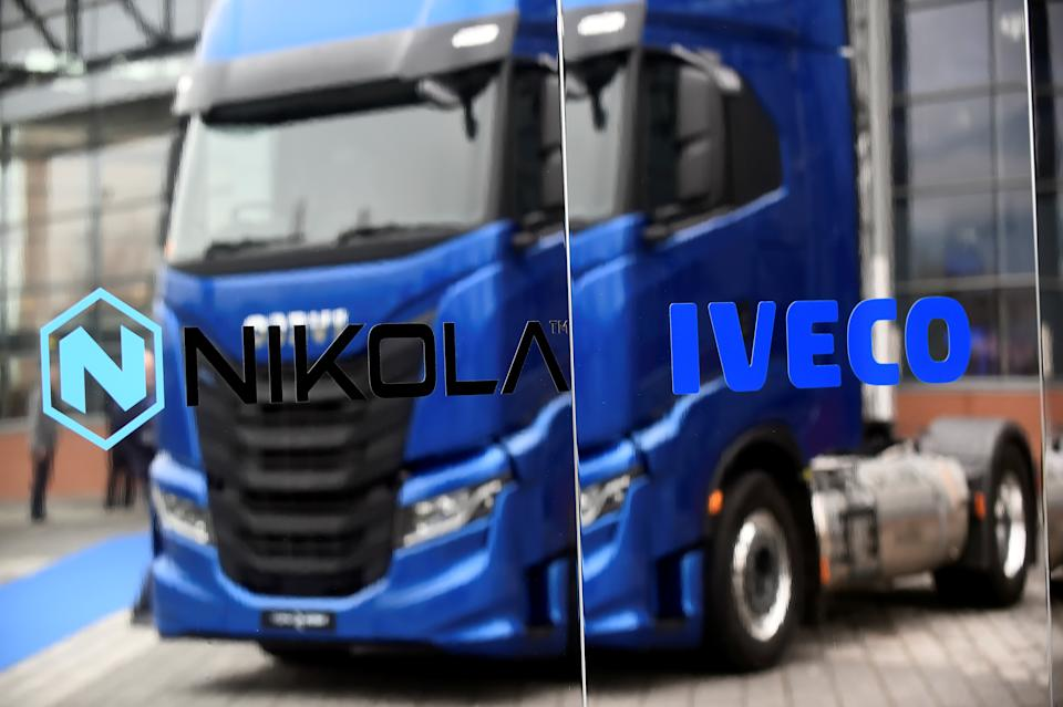 U.S. Nikola's and Iveco logo are pictured at an event held to present CNH's new full-electric and Hydrogen fuel-cell battery trucks in partnership with U.S. Nikola event in Turin, Italy, December 3, 2019. REUTERS/Massimo Pinca