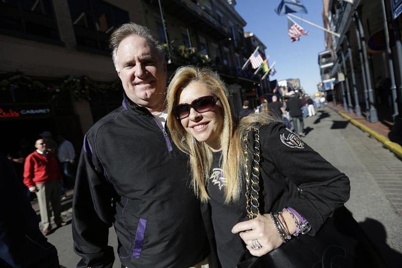 """In this Friday, Feb. 1, 2013 photo, Sean and Leigh Anne Tuohy, adoptive parents of Baltimore Ravens starting offensive lineman Michael Oher, stand on a street in New Orleans. They were depicted in the move """"The Blind Side"""" and will be attending Sunday's NFL football Super Bowl between the Ravens and the San Francisco 49ers. (AP Photo/Gerald Herbert)"""