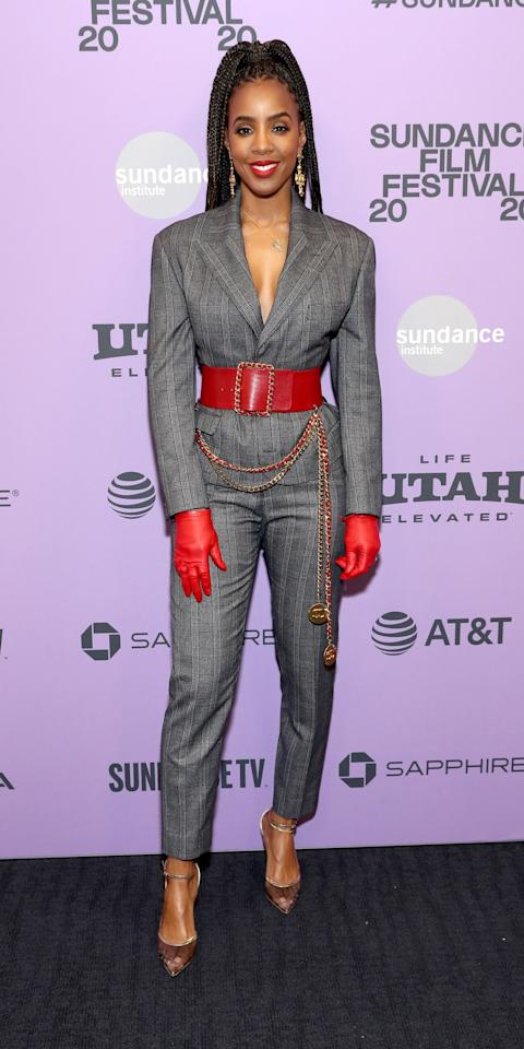 <p>During the Sundance Film Festival, Kelly Rowland gave a classic suit an upgrade with a bold red belt, matching gloves, and transparent pumps.</p>