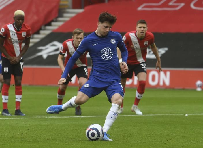Chelsea's Mason Mount scores on a penalty kick during the English Premier League soccer match between Chelsea and Southampton at St. Mary's Stadium in Southampton, England, Saturday, Feb.20, 2021. (Neil Hall/Pool via AP)