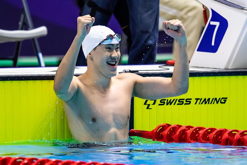 Singapore swimmer Darren Chua celebrates winning the SEA Games gold in the men's 100m freestyle over Joseph Schooling. (PHOTO: SNOC/Andy Chua)