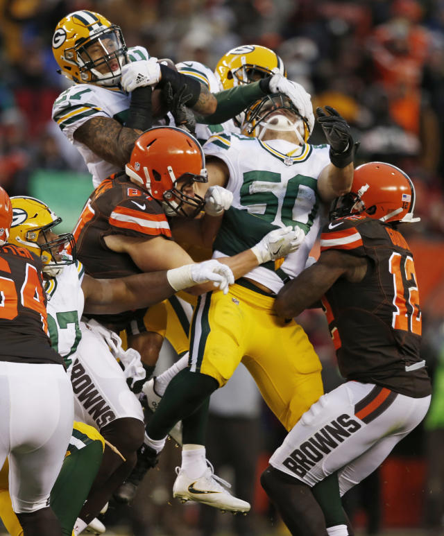 <p>Green Bay Packers strong safety Josh Jones, top center, catches an interception in the second half of an NFL football game against the Cleveland Browns, Sunday, Dec. 10, 2017, in Cleveland. The Packers won 27-21. (AP Photo/Ron Schwane) </p>