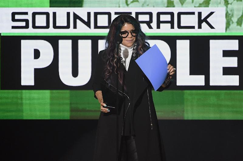 Tyka Nelson as she accepts Top Soundtrack for 'Purple Rain' on behalf of her brother, the late musician Prince, onstage during the American Music Awards in November 2016 (AFP Photo/Kevin Winter)