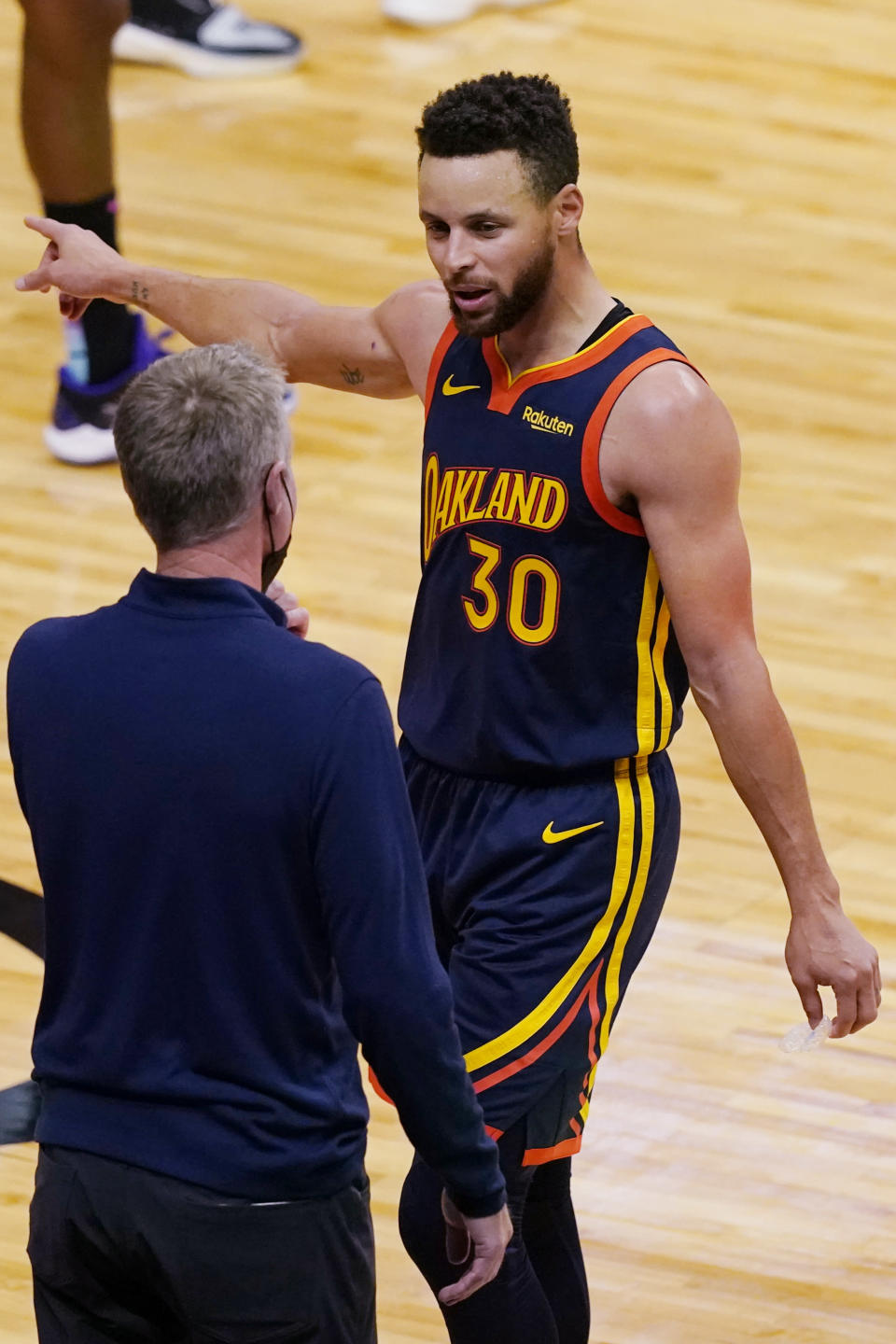Golden State Warriors guard Stephen Curry (30) talks to head coach Steve Kerr during the second half of an NBA basketball game against the Miami Heat, Thursday, April 1, 2021, in Miami. (AP Photo/Marta Lavandier)