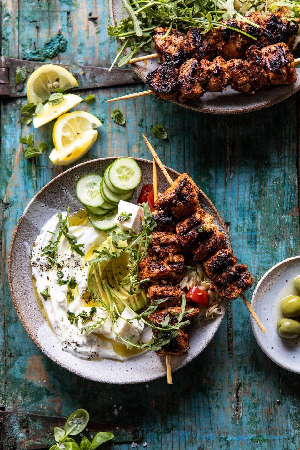"""<p>Orzo, roasted peppers, avocado, feta cheese, cucumbers, and an addicting dressing are just a few of the reasons these bowls are at the top of our list.</p><p><strong>Get the recipe at <a href=""""https://www.halfbakedharvest.com/greek-lemon-chicken-bowls/"""" rel=""""nofollow noopener"""" target=""""_blank"""" data-ylk=""""slk:Half Baked Harvest"""" class=""""link rapid-noclick-resp"""">Half Baked Harvest</a>.</strong> </p><p><a class=""""link rapid-noclick-resp"""" href=""""https://go.redirectingat.com?id=74968X1596630&url=https%3A%2F%2Fwww.walmart.com%2Fip%2FThe-Pioneer-Woman-Frontier-Collection-13-Teal-Slotted-Spatula%2F547532946&sref=https%3A%2F%2Fwww.thepioneerwoman.com%2Ffood-cooking%2Fmeals-menus%2Fg32188535%2Fbest-grilling-recipes%2F"""" rel=""""nofollow noopener"""" target=""""_blank"""" data-ylk=""""slk:SHOP SPATULAS"""">SHOP SPATULAS</a></p>"""